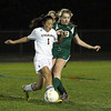Ipswich senior Lia Ziegler collides with Manchester-Essex junior Kelley Moore, as they battle for possession of the ball. David Le/Staff Photo