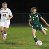 Manchester-Essex freshman Bella Mastendino, right, boots the ball upfield while being pursued by Ipswich senior Brigid O'Flynn on Tuesday evening. David Le/Staff Photo