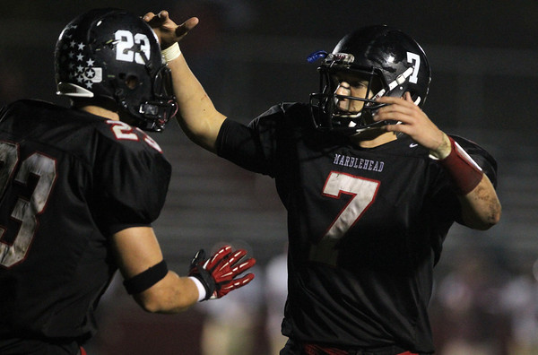 Marblehead senior captain Ian Maag, right, greets running back Jeremy Gillis, left, after he scored on a touchdown pass from Maag against Gloucester on Friday evening. David Le/Staff Photo