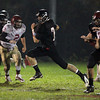 Marblehead senior quarterback Ian Maag breaks into the open field against Gloucester on Friday evening. David Le/Staff Photo