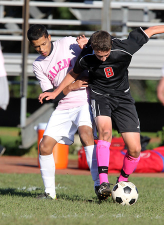 Salem's Robert Abreu, left, contests Marblehead's Cole Guyre as he posseses the ball in midfield on Friday afternoon. David Le/Staff Photo