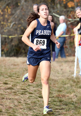 Peabody High School senior Catarina Rocha ran away from the rest of the field at Saturday's NEC Cross Country Championships, crossing the line in a course record time of 17:22, breaking Shalane Flanagan's record of 17:45 from '99. Rocha led the way for the Tanners as they took the first three spots overall and also captured the team title with 25 points. David Le/Staff Photo