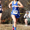 Danvers High School freshman Abby Armstrong runs hard to the finish line during the NEC Cross Country Championship at Bradley Palmer State Park in Hamilton on Saturday afternoon. David Le/Staff Photo
