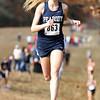 Peabody senior Heather McLean comes in second overall in the NEC Cross Country Championship meet at Bradley Palmer State Park on Saturday afternoon. The Tanners took home the top 3 spots led by senior Catarina Rocha, McLean, and sophomore Lauren Barrett, and also captured the team title with 25 points. David Le/Staff Photo