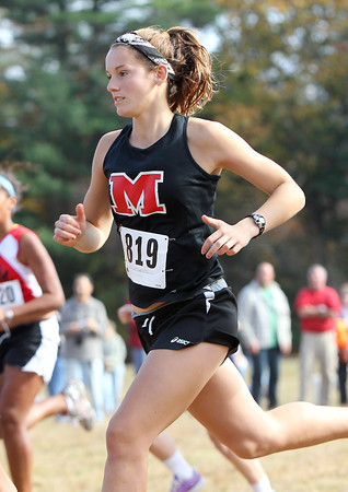 Marblehead senior Kelly Roland runs hard off the starting line for the Magicians during the NEC Cross Country Championship at Bradley Palmer State Park in Hamilton on Saturday afternoon. David Le/Staff Photo