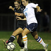 Peabody senior striker Victoria Digiacomo, right, battles for position with Beverly senior Becca Kemmer, left, on Friday evening.  David Le/Staff Photo