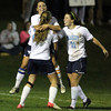 Peabody senior striker Victoria Digiacomo, center, gets hugged by teammates Madison Doherty, left, and Hayley Dowd, right, after scoring the first of her two goals against Beverly on Friday evening. David Le/Staff Photo