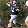 Pingree senior quarterback Jerome Cappadona drops back and fires a pass against Holderness on Saturday afternoon. David Le/Staff Photo