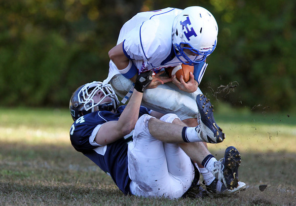 Pingree sophomore William Ager, left, sacks Holderness quarterback Jesse Ross, during the second half of play on Saturday afternoon. David Le/Staff Photo