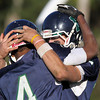 Pingree junior John Spears, left, and senior quarterback Jerome Cappadona, celebrate a Pingree score against Holderness on Saturday afternoon. David Le/Staff Photo