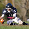 Pingree sophomore Salvatore Fazio falls on a squibbed kickoff by Holderness on Saturday afternoon. David Le/Staff Photo