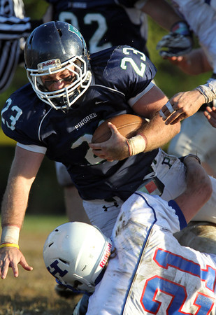 Pingree senior captain Nick Antenucci runs over a Holderness defender after picking up a solid chunk of yards on Saturday afternoon. David Le/Staff Photo