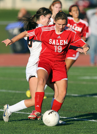 Salem sophomore Katherine Towey, right, shields the ball while being pressured by Beverly junior striker Caitlin Harty, left, on Thursday afternoon. David Le/Staff Photo