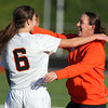 Beverly High School junior striker Caitlin Harty, gets a hug from Beverly Head Coach Kristin Simpson after Harty scored the 34th goal of her 2012 campaign, breaking Beverly High's single season goals record of 33. Harty scored 4 total goals and paced the Panthers to a 5-2 victory over the Salem Witches in NEC action on Thursday afternoon. David Le/Staff Photo