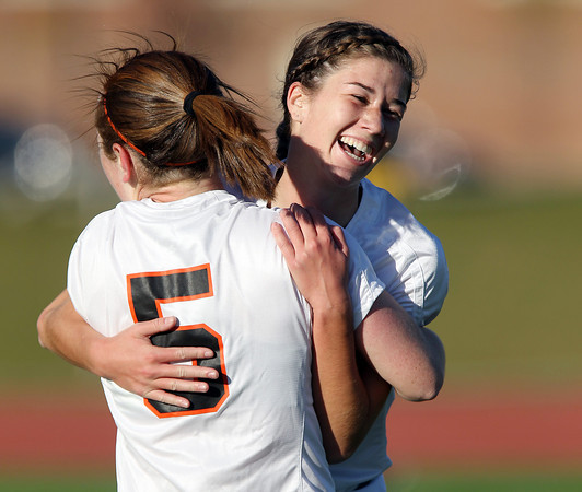 Beverly High School junior striker Caitlin Harty, gets a hug from teammate Sarah Visnick after Harty scored the 34th goal of the 2012 season, breaking the Panthers' single season goals record of 33. Harty scored 4 total goals and paced Beverly to a 5-2 victory over the Salem Witches in NEC action on Thursday afternoon. David Le/Staff Photo
