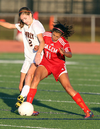 Beverly senior Meggie Manzo, left, and Salem sophomore Deema Hijleh, right, collide as they battle for possession of the ball on Thursday afternoon. David Le/Staff Photo