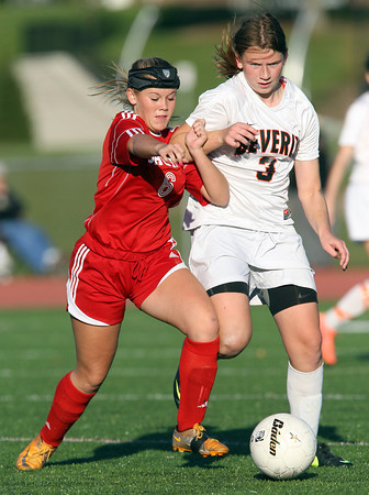 Salem sophomore Sydney Hanford, left, battles for position with Beverly junior Casey Cook, right, during the first half of play on Thursday afternoon at Beverly High School. David Le/Staff Photo