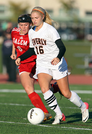 Beverly sophomore Eva Gourdeau, right, controls the ball in the midfield while being pursued by Salem's sophomore Sydney Hanford, left, during the first half of play on Thursday afternoon. David Le/Staff Photo