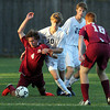 St. John's Prep senior captain Brooks Clark (10) defends BC Highsenior captain Caleb Long, left, during the second half of play on Wednesday afternoon. David Le/Staff Photo