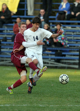 St. John's Prep junior striker Matthew Chilton, right, gets tangled up with a BC High player as they battle for the ball on Wednesday afternoon. David Le/Staff Photo