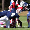 St. John's Prep senior Nathaniel Cabral flips St. John's Shrewsbury running back Shadrach Abrokwah, center, on his head as St. John's Prep teammates Michael Fawehinmi, right, and Lucas Bavaro, left, come in to help complete the tackle. David Le/Staff Photo