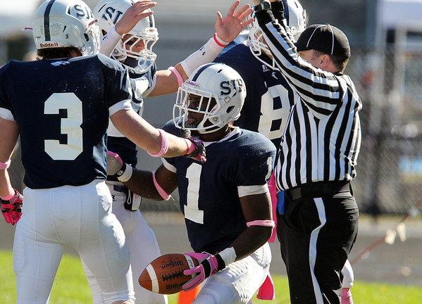 St. John's Prep junior running back Johnny Thomas (1) gets greeted by teammates after ripping off a long touchdown run against St. John's Shrewsbury on Saturday afternoon. David Le/Staff Photo
