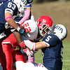 St. John's Shrewsbury running back Shadrach Abrokwah, center, gets taken down for negative yardage by St. John's Prep seniors Lucas Bavaro, right, and Chris Newton, left, on Saturday afternoon. David Le/Staff Photo
