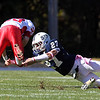 St. John's Prep senior Alex Moore makes a diving tackle on a St. John's Shrewsbury ball carrier on Saturday afternoon. David Le/Staff Photo