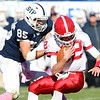 St. John's Prep senior defensive lineman Anthony Bongiorno, left, drags down St. John's Shrewsbury quarterback Andrew Smiley, right, for a sack on Saturday afternoon. David Le/Staff Photo