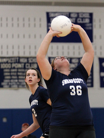 Swampscott's Ali Carreiro, right, sets the ball to teammate Taylor Irwin, left, against Saugus on Friday evening. David Le/Staff Photo