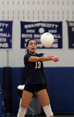Swampscott junior Faye Liakopoulos passes the ball to a teammate against Saugus on Friday afternoon. David Le/Staff Photo