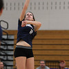 Swampscott High School junior Taylor Irwin spikes the ball over the net against Saugus on Friday evening. David Le/Staff Photo