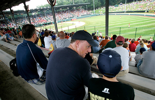 Williamsport: Mike Dellisola of Peabody, speaks to his son, Derek, during the Canada vs Mexico game, during the 2009 Little League World Series. Next to them is friend, Stephen Marsella of Beveryl. Photo by Mark Lorenz/Salem News