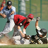 Williamsport: Peabody West third baseman, Nick Bona tags out Great Lakes is Ian Woodall. Peabody defeating Great Lakes in their final game at the Little League World Series. Photo by Mark Lorenz/Salem News