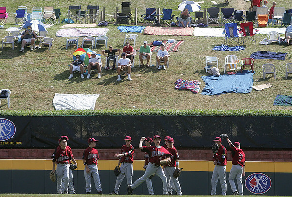 Williamsport: Peabody West players take to the outfield during pre game warm ups, in their final game against the Great Lakes. Peabody won 12-3,  at the Little League World Series. Photo by Mark Lorenz/Salem News