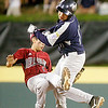 Williamsport: Southwest's Travis Daves collides with Peabody West's Michael Petrosino at second base. Peabody fell 10-1. Photo by Mark Lorenz/Salem News