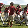 Williamsport: Peabody West players get a high five from, Hannah Montana's Moises Arias, who plays Rico on the hit T.V. show. Peabody played thier final game against the Great Lakes at the Little League World Series. The won 12-3. Photo by Mark Lorenz/Salem News
