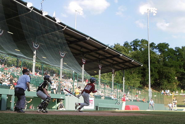 Williamsport: Peabody West Austin Batchelor watches the ball sail out of the park, in the teams first home run at the Little League World Series. Peabody West defeating Great Lakes in their final game. Photo by Mark Lorenz/Salem News