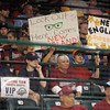 Williamsport: Peabody West fans hold signs in the second inning of play, as Peabody faced Southwest at the 2009 Little League World Series. Peabody fell 10-1. Photo by Mark Lorenz/Salem News