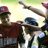 Williamsport: Peabody West team congragulates, Michael Petrosino after striking out a Great Lakes player to win the game, giving Peabody a 12-3 victory and their first win at the Little League World Series. Photo by Mark Lorenz/Salem News