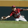 Williamsport: Peabody West center fielder Matt Correale cannot keep the ball in his glove on this fly ball in game against the Great Lakes. Peabody won their final game 12-3 at he Little League World Series. Photo by Mark Lorenz/Salem News