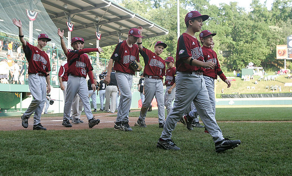 Williamsport: Peabody West team waves to their parents after defeating Great Lakes in their final game at the Little League World Series. Photo by Mark Lorenz/Salem News