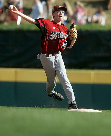 Williamsport: Peabody West short stop, Matt Hosman, throws for an out to first base. Peabody defeating the Great Lakes in their final game at the Little League World Series, 12-3.  Photo by Mark Lorenz/Salem News