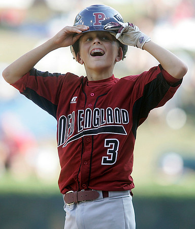 Williamsport: Peabody West Traverse Briana looks into the stands, after a base hit in game agaisnt the Great Lakes, at the Little League World Series. Photo by Mark Lorenz/Salem News