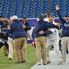Foxborough: Pingree coaches burst into joyful hugs at the team's comeback win in the Norm Walker Bowl at Gillette Stadium. photo by Mark Teiwes / Salem News