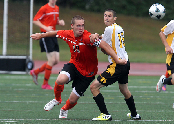 Beverly senior captain Cam Rogers, left, keeps his eyes on the ball as he fights past Bishop Fenwick Nick Gulla, right, on Tuesday afternoon. David Le/Staff Photo