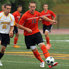 Beverly senior captain Cam Rogers, right, controls the ball while being pursued by Bishop Fenwick senior captain Drew Thibodeau, left, on Tuesday afternoon at Bishop Fenwick High School. David Le/Staff Photo