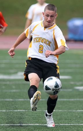 Bishop Fenwick senior Captain Mike MacKenzie boots the ball upfield while playing against Beverly on Tuesday afternoon. David Le/Staff Photo