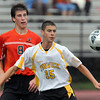 Bishop Fenwick's Nick Gulla, right, shields the ball from Beverly's Nate McGlaughlin, during the first half of play on Tuesday afternoon. David Le/Staff Photo