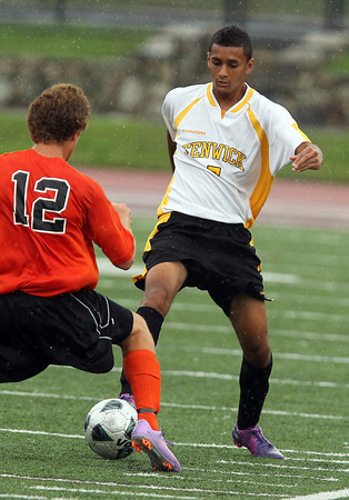 Bishop Fenwick Rishad DeSilva, right, reaches foward and pokes the ball through the legs of Beverly defender Elias Crandell on Tuesday afternoon. David Le/Staff Photo